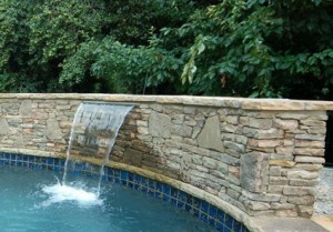 Waterfalls can create a feel of paradise to any pool.