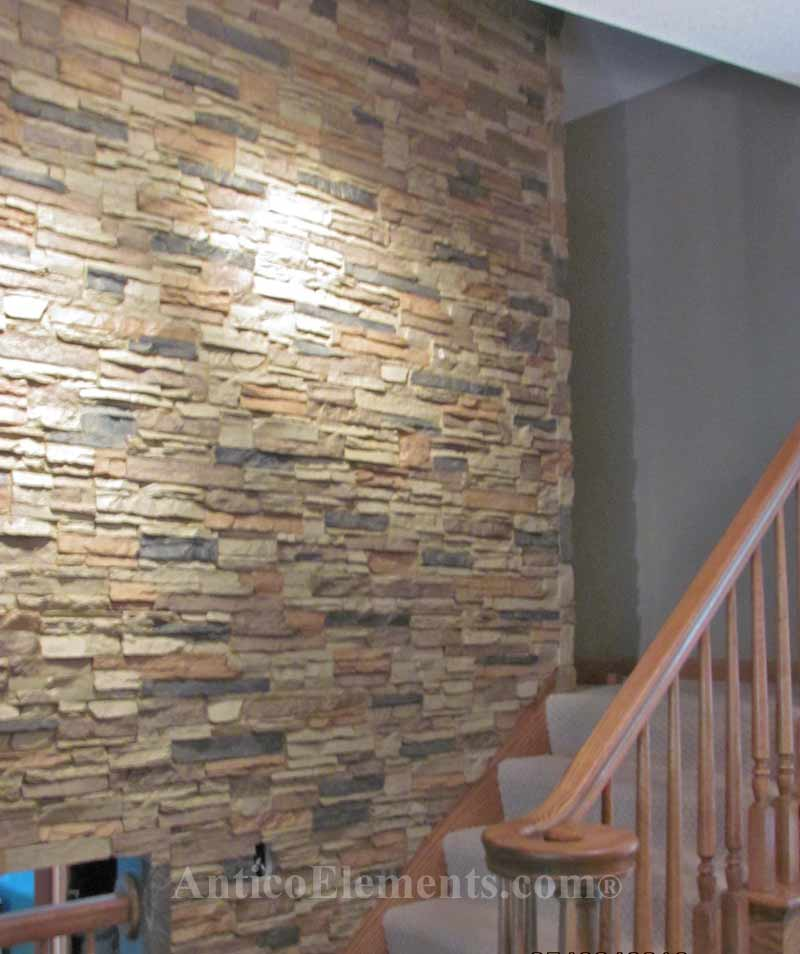 Quickly installed faux wall stone panels in sand.