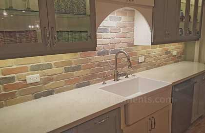 brick paneling used as backsplash