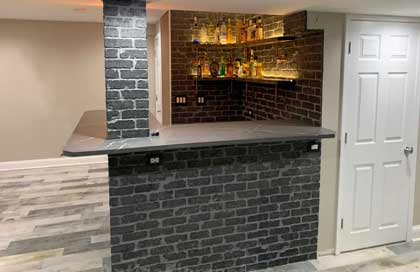 Charcoal brick paneling in basament
